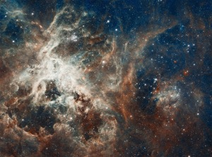 "This is 30 Doradus, deep inside the Tarantula Nebula, located over 170,000 light-years away in the Large Magellanic Cloud, a small satellite galaxy of the Milky Way. Millions of ""baby stars"" are birthed inside the thick clouds of dust and gas, and our God knows each one by name. Source: http://hubblesite.org/newscenter/archive/releases/2012/2012/01/results/100/ NASA, ESA, and the Hubble Heritage (STScI/AURA)-ESA/Hubble Collaboration"